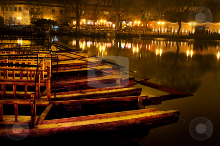 Wooden Boats Houhaid Lake Night Beijing China stock photo, Wooden Boats, Houhai Bacl Lake, Beijing, China  Houhai Lake is in the back of Beihai Lake in Beijing.  It used to be the swimming hole in Beijing and now is surrounded by restaurants and bars, which makes it a beautiful place at night. by William Perry