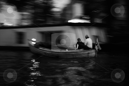 Couple in a boat stock photo, Couple in a boat in Amsterdam by Roman Kalashnikov