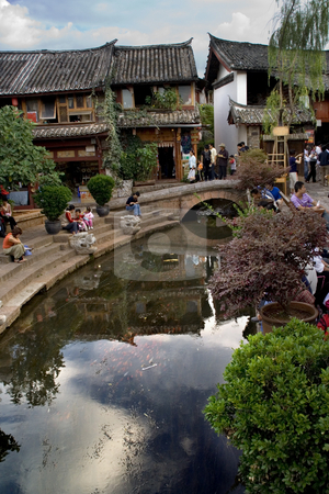 Old Town Lijiang Yunnan Province China stock photo, Old Town Lijaing Yunnan Province China.  Lijiang is a city of canals and this is the center of the city with a reflection in the Canal by William Perry