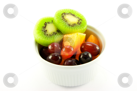 Kiwi, Melon and Grapes stock photo, Pot of fruit including kiwi, melon and grapes with clipping path on a white background by Keith Wilson