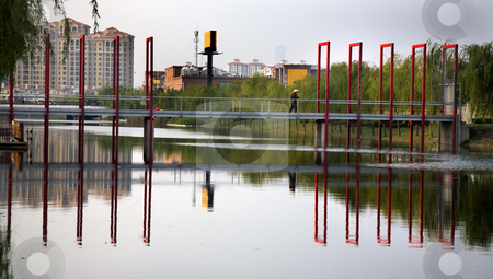 Red Bridge Reflections Shanghai Suburbs  stock photo, Red Bridge Reflections Weilaiyu Shanghai Suburbs China Modern Apartments Trademarks removed. by William Perry