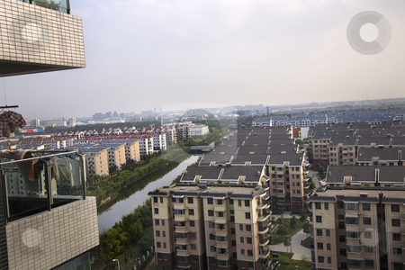 Shanghai Suburbs stock photo, Shanghai Suburbs Residential Area apartments river, living area With Trademarks. by William Perry