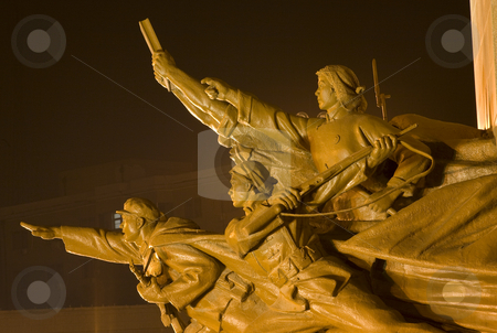 MaoZedong Statue Side View of Heroes Zhongshan Square, Shenyang, stock photo, Mao Zedong Statue with Heroes Zhongshan Square Shenyang, Liaoning Province, China at Night.  Built in 1969 during the Cultural Revolution.  The hero is holding a copy of Mao Zedong Thought by William Perry