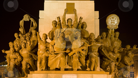 Mao Statue View of Heroes Zhongshan Square, Shenyang, China at N stock photo, Mao Statue Heroes at the Base of Statue Zhongshan Square Shenyang, Liaoning province, China at Night.  Built in 1969 during the Cultural Revolution.  One hero is holding up copy of a book on the thoughts of Mao Zedong. by William Perry