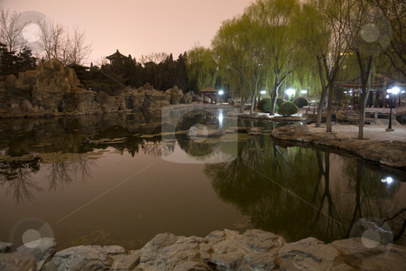 Temple of Sun Park Pond Reflection Beijing, China stock photo, Temple of Sun Park, Pond Reflection, Evening, Night Shot, Beijing, China by William Perry