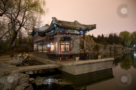 Stone Boat Temple of Sun Beijing China stock photo, Stone Boat Bar Temple of Sun Beijing China Evening Pond Reflection by William Perry