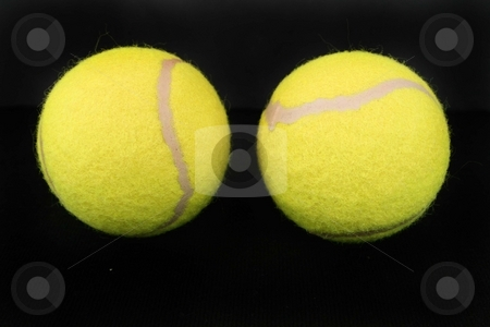 Two yellow tennis balls stock photo, Two yellow tennis balls by Shirley Mathews