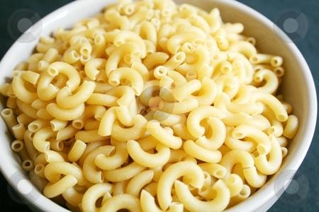 Uncooked macaroni stock photo, Uncooked macaroni in bowl by Shirley Mathews