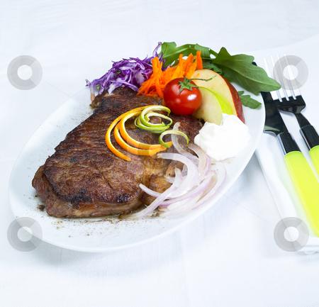 Beef ribeye steak stock photo, Fresh juicy beef ribeye steak grilled with lemon and orange peel on top and vegetables beside with sour cream by Francesco Perre
