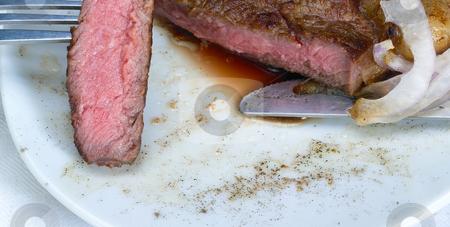 Beef ribeye steak stock photo, Fresh juicy beef ribeye steak grilled,sliced on a plate by Francesco Perre