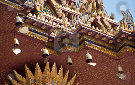 Peace bells sway at buddhist temple in bangkok stock photo,  by Shi Liu