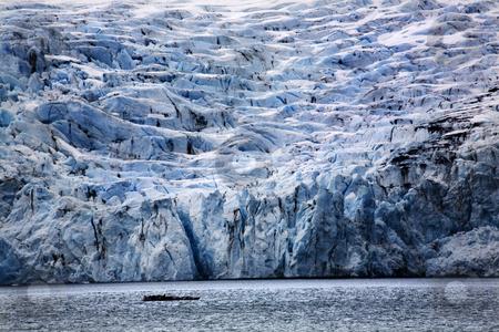 Blue Big Portage Glacier Anchorage Alaska stock photo, Blue Big Icy Portage Glacier Lake, Anchorage, Alaska  The blue is from the glacier. by William Perry