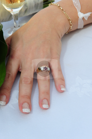 Bride showing wedding ring stock photo, A newlywed bride showing off her wedding ring. by Nicolaas Traut