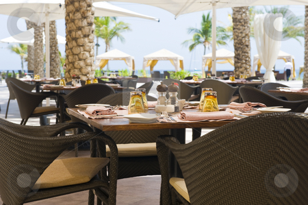 Outside restaurant stock photo, An outside restaurant at a hotel with nice place settings. by Nicolaas Traut