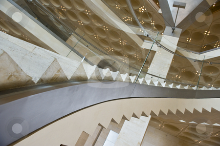Modern stairs stock photo, A modern curved staircase in a luxurious building. by Nicolaas Traut