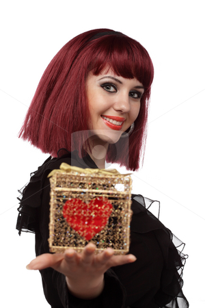 Beautiful woman with heart packed in a golden gift box stock photo, Beautiful woman smiling with heart packed in a golden gift box in her hand.Shallow DOF,focus on the face. by Ivelin Radkov