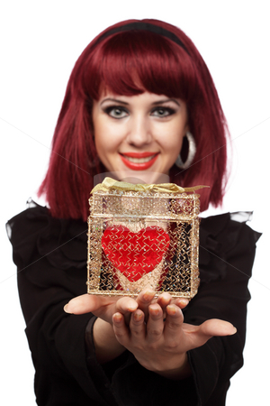 Happy girl smiling with heart packed in a golden gift box stock photo, Happy woman smiling with heart packed in a golden gift box in her hand.Shallow DOF,focus on the heart. by Ivelin Radkov