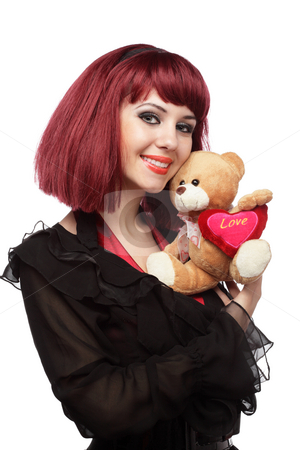 Happy girl with Teddy bear with heart in her hands stock photo, Beautiful woman with Teddy bear with heart in her hands by Ivelin Radkov