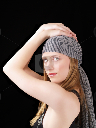Young woman with scarf hands on head stock photo, Young blond woman with hands on head scarf by Jeff Cleveland