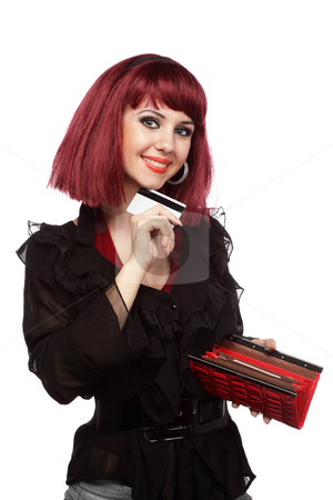 Happy woman holding credit card and wallet stock photo, Happy woman holding credit card and wallet over white by Ivelin Radkov