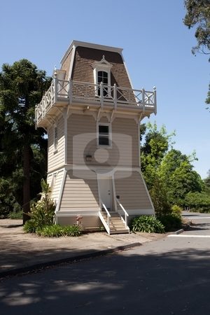 Water Tower stock photo, Water tower or elevated water tower is a large elevated water storage container constructed for the purpose of holding a water supply at a height sufficient to pressurize a water distribution system. by Mariusz Jurgielewicz
