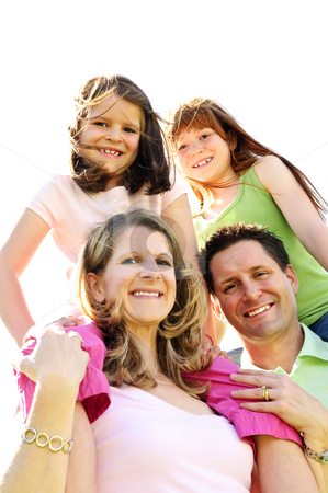 Happy family stock photo, Portrait of happy family giving children shoulder rides by Elena Elisseeva