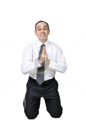 Business man in suit stock photo, Business man praying in suit isolated on white background by Elena Elisseeva