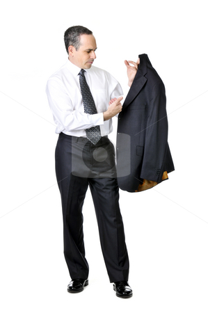 Business man in suit stock photo, Business man brushing his suit isolated on white background by Elena Elisseeva