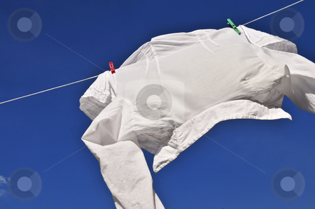 White shirt on clothes line stock photo, White shirt hanging to dry on clothes line by Elena Elisseeva