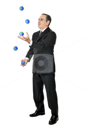 Businessman juggling stock photo, Business man in suit juggling planet earth balls by Elena Elisseeva