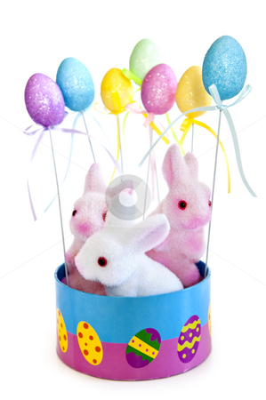 Easter bunny toys stock photo, Cute Easter bunny toys in basket with balloons isolated on white background by Elena Elisseeva
