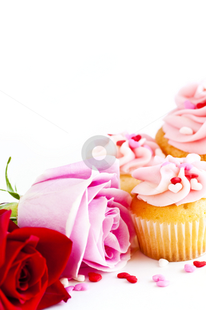 Cupcakes and flowers stock photo, Valentines day roses and cupcakes with pink icing by Elena Elisseeva