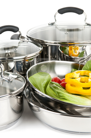 Stainless steel pots and pans with vegetables stock photo, Stainless steel pots and pans isolated on white background with vegetables by Elena Elisseeva