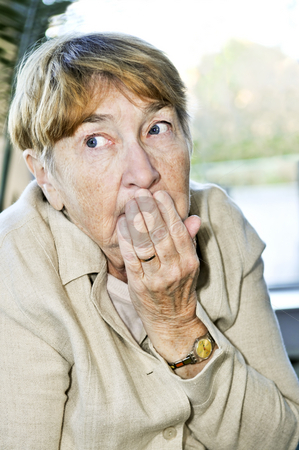 Scared elderly woman stock photo, Afraid elderly woman looking sideways in fear by Elena Elisseeva