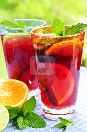 Fruit punch in glasses stock photo, Refreshing fruit punch in two glasses outside by Elena Elisseeva