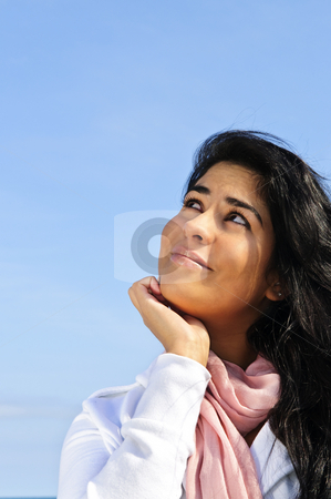 Beautiful young woman stock photo, Portrait of beautiful smiling girl looking up by Elena Elisseeva