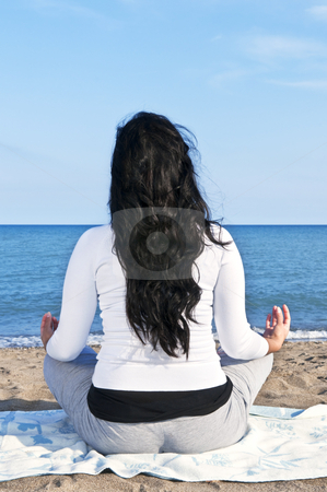 Young native american woman meditating stock photo, Portrait of beautiful native american girl doing yoga at beach by Elena Elisseeva