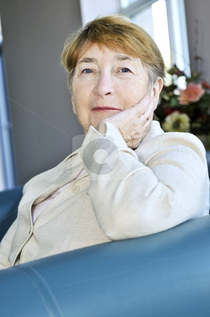 Elderly woman stock photo, Elderly woman sitting in white linen jacket by Elena Elisseeva