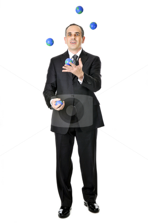 Businessman juggling stock photo, Business man in suit juggling planet earth balls by Elena Elisseeva