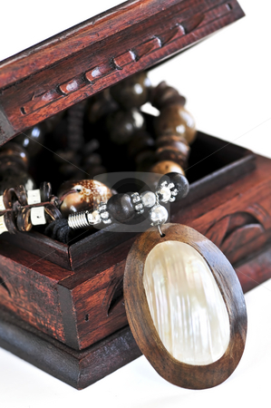 Wooden jewelry box stock photo, Beautiful handcrafted wooden box with aboriginal jewelry by Elena Elisseeva