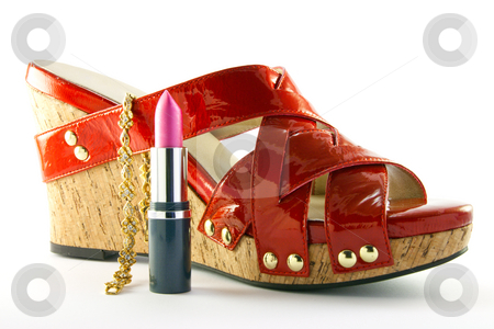 Red Shoe with Lipstick and Bracelet stock photo, Single red shoe with pink lipstick and gold bracelet with clipping path on a white background by Keith Wilson