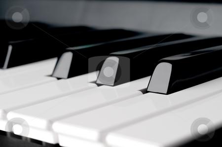 A shallow focus horizontal close up of piano keyboard  keys stock photo, A shallow focus horizontal close up of piano keyboard  keys by Vince Clements