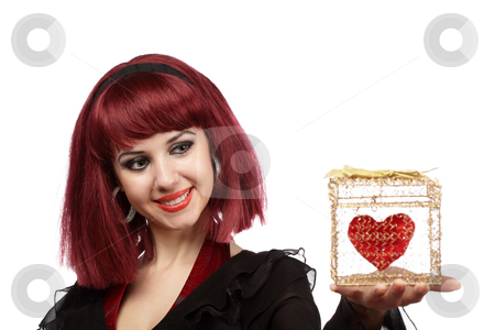Happy woman with heart packed in a golden gift box stock photo, Happy woman smiling with heart packed in a golden gift box in her hand.Shallow DOF,focus on the face. by Ivelin Radkov