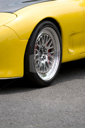Racing Rims stock photo, A closeup of the custom rims on a modern sports car with plenty of copyspace. by Todd Arena