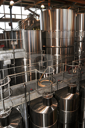 Wine making equipment stock photo, Wine making vats and equipment in tour of winery by Elena Elisseeva