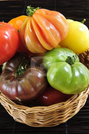 Heirloom tomatoes stock photo, Wicker basket full of multi colored heirloom tomatoes by Elena Elisseeva