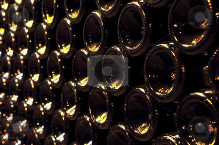 Wine bottles stock photo, Large stack of wine bottle bottoms in winery by Elena Elisseeva
