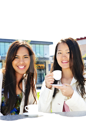 Girlfriends having coffee stock photo, Two girl friends sitting and having drinks at outdoor mall by Elena Elisseeva