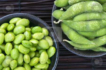 Soy beans in bowls stock photo, Edamame soy beans shelled and with pods in bowls by Elena Elisseeva