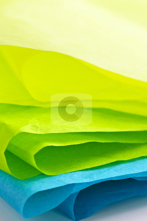 Tissue paper stock photo, Close up of blue green and yellow tissue paper by Elena Elisseeva